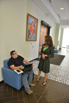 Incoming Texas A&M San Antonio President Cynthia Teniente-Matson talks to student Juan Alvarado recently. Behind her is a portrait of the school's inaugural president Dr. Maria Hernandez Ferrier. Photo: ROBIN JERSTAD, San Antonio Express-News