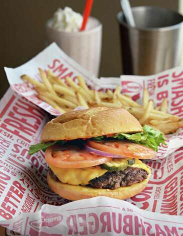 Classic smash burger with smash fries and a hand-spun strawberry shake at Smashburger on Wolf Road Wednesday Feb. 11, 2015, in Colonie, NY.  (John Carl D'Annibale / Times Union) Photo: John Carl D'Annibale / 00030530A