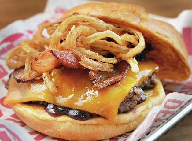 A BBQ, Bacon and Cheddar burger at Smashburger on Wolf Road Wednesday Feb. 11, 2015, in Colonie, NY.  (John Carl D'Annibale / Times Union) Photo: John Carl D'Annibale / 00030530A
