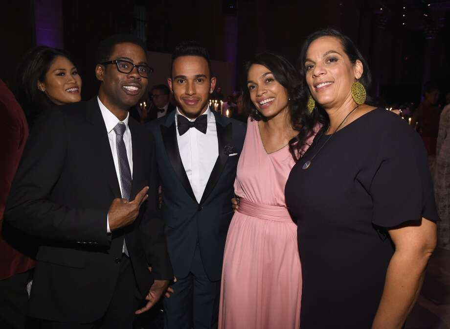 (L-R) Chris Rock, Lewis Hamilton, Rosario Dawson and Isabel Celeste attend the 2015 amfAR New York Gala at Cipriani Wall Street on February 11, 2015 in New York City.  (Photo by Larry Busacca/Getty Images) Photo: Larry Busacca, Getty Images