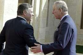 Jordan's King Abdullah II greets Prince Charles Feb. 8.