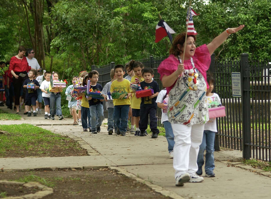 Children from St. Anthony Catholic school participate Thursday afternoon, April 22, 2004, in the school's shoe box Fiesta parade.  Photo: WILLIAM LUTHER, SAN ANTONIO EXPRESS-NEWS / SAN ANTONIO EXPRESS-NEWS