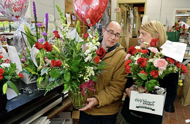 Transportation manager Frank Chromic, left, and floral designer Mary Hotaling with finished arrangements for Valentine's Day at Emil J. Nagengast Florist Thursday Feb. 12, 2015, in Albany, NY.  (John Carl D'Annibale / Times Union) Photo: John Carl D'Annibale