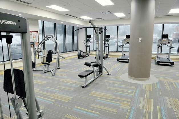 A view of the fitness room available for tenants to use inside the Executive Park Tower in the Stuyvesant Plaza Executive Park on Thursday, Feb. 12, 2015, in Guilderland, N.Y.  The building has gone through a multi-million dollar capital investment project which began in January 2013.  The building sits on 12 acres behind Stuyvesant Plaza, featuring 170,000 square feet of office space and on-site parking for over 1,000 cars.  (Paul Buckowski / Times Union) Photo: Paul Buckowski / 00030566A