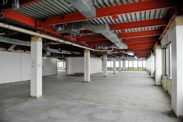 A view of the 10th floor inside the Executive Park Tower in the Stuyvesant Plaza Executive Park on Thursday, Feb. 12, 2015, in Guilderland, N.Y.  The floor is unfinished so that a tenant can decide what the final look of the floor would be.  The building has gone through a multi-million dollar capital investment project which began in January 2013.  The building sits on 12 acres behind Stuyvesant Plaza, featuring 170,000 square feet of office space and on-site parking for over 1,000 cars.  (Paul Buckowski / Times Union) Photo: Paul Buckowski / 00030566A