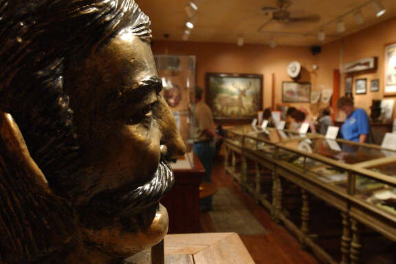 "A bust of ""King"" Fisher, who reportedly killed 26 men and who was himself killed in San Antonio, looks out over a collection entitled ""Gunfighters: Outlaws and Lawmen of the Old West"" on display at the Buckhorn Saloon and Museum in 2003."