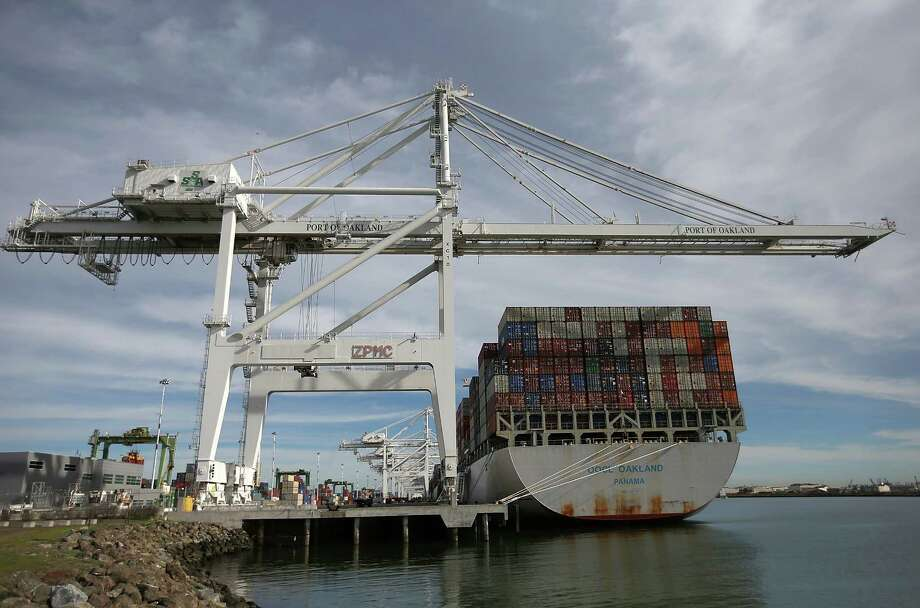 A container ship is docked in Oakland, Calif., this week. West Coast ports are having a slowdown.  Photo: Justin Sullivan, Staff / 2015 Getty Images