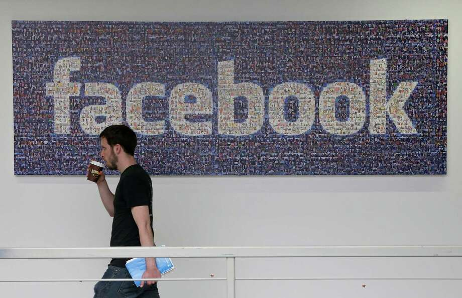 Facebook will let users choose if they want to pass account management to someone else when they die.  Photo: Jeff Chiu, STF / AP