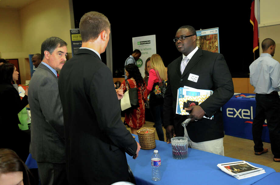Jacobi Hunter, 19, right, a Sam Houston State University banking student from Cypress, takes part in a business career day. Photo: Jerry Baker, Freelance