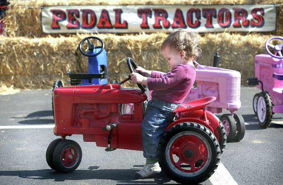 Connor Cooper, 13 mo.,  tries out a riding tractor at the new Cowboy Bootcamp at San Antonio Stock Show and Rodeo.  Thursday, Feb. 12, 2015. Photo: Bob Owen, San Antonio Express-News / ©2015 San Antonio Express-News