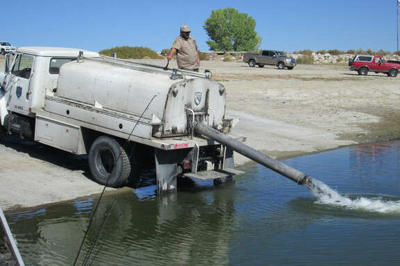 A Department of Fish and Wildlife truck plants hatchery-raised rainbow trout at Crowley Lake in the Eastern Sierra last year.