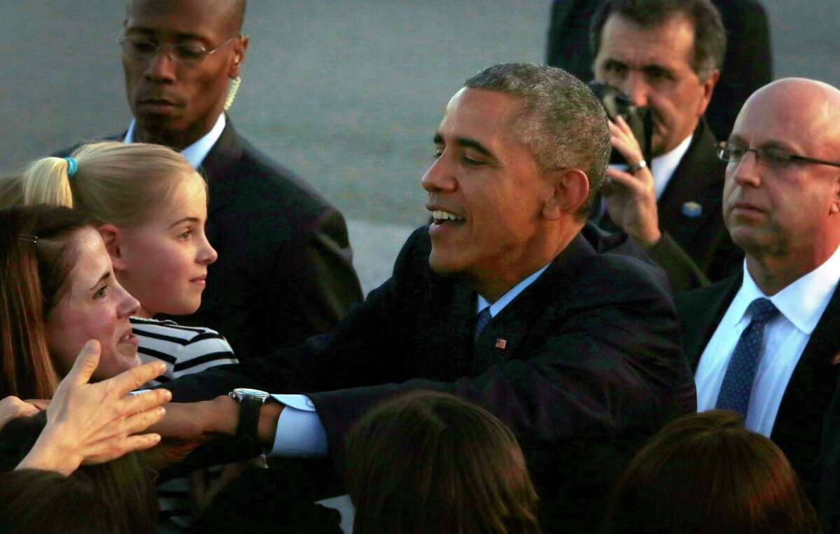 President Obama greets military families and other VIPs at San Francisco International Airport on Feb. 12.