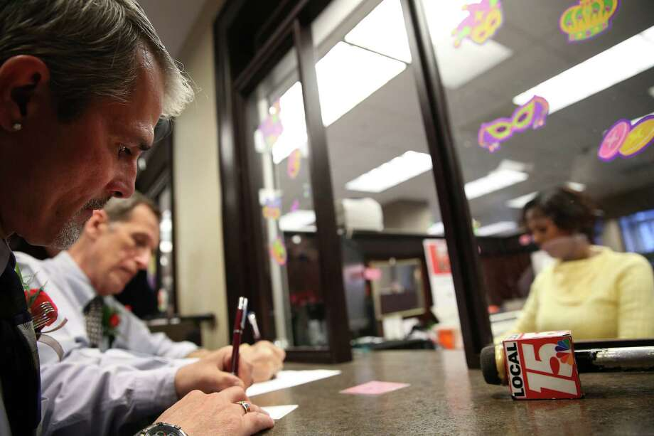 Robert Povilat, left, and Milton Persinger apply for their marriage license at the Mobile County (Ala.)  Probate Office after windows opened on Thursday.  for the first time in four days in Mobile, Ala., Thursday Feb. 12, 2015. (AP Photo/Mobile Press-Register, Sharon Steinmann) Photo: Sharon Steinmann, MBI / Mobile Press-Register
