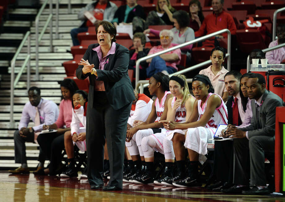 Lamar Head Coach Robin Harmony calls out to her players during Thursday's game against Houston Baptist. The Lamar Lady Cardinals hosted the Houston Baptist Huskies at the Montagne Center on Thursday night. Photo taken Thursday 2/12/15 Jake Daniels/The Enterprise Photo: Jake Daniels / ©2014 The Beaumont Enterprise/Jake Daniels
