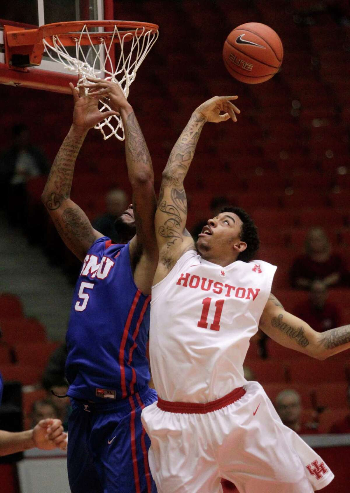 Houston Cougars JC Washington (5) takes a shot over SMU's Markus Kennedy (5) during the second half of a college basketball game on Thursday, Feb. 12, 2015, in Houston.