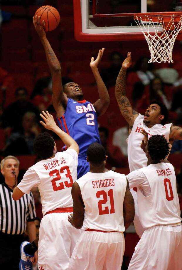 SMU's 6-11 Yanick Moreira attracts a crowd while launching a shot. Moreira scored six points and had a team-high nine rebounds to help the Mustangs overwhelm the Cougars inside. Photo: J. Patric Schneider, Freelance / © 2015 Houston Chronicle