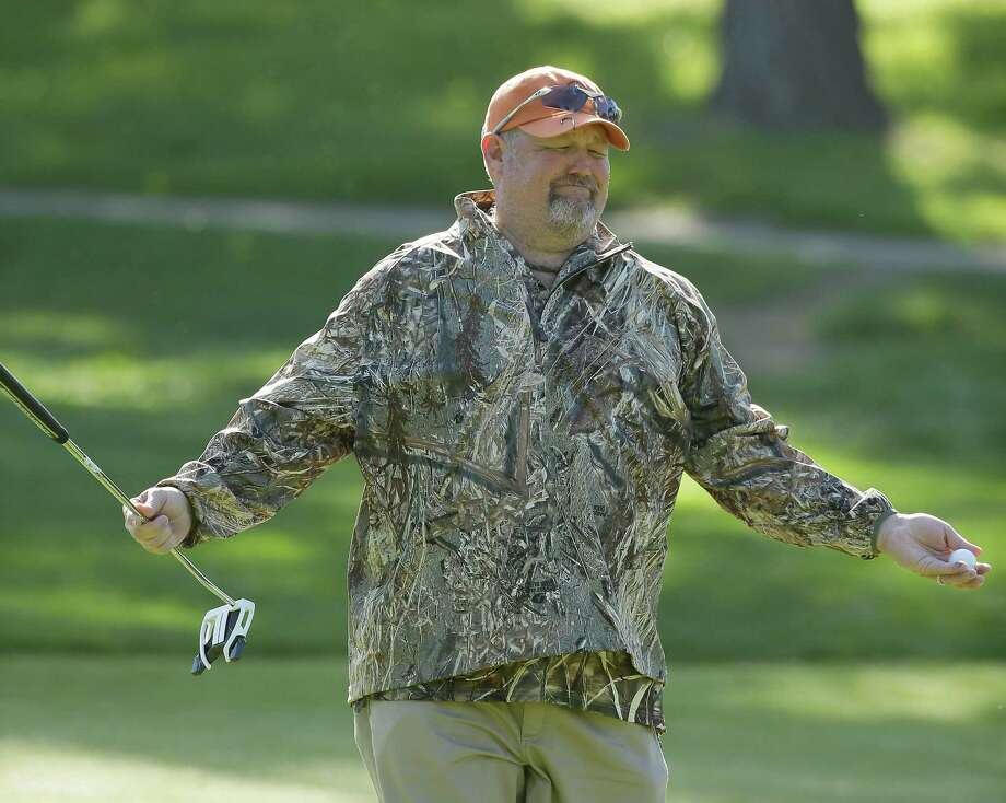 "It was no joke as Daniel Lawrence ""Larry"" Whitney, better known as Larry the Cable Guy, sank his putt on the first green in the first round of the Pebble Beach National Pro-Am at Monterey Peninsula. Photo: Eric Risberg, STF / AP"