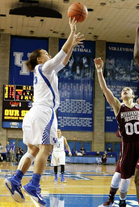 Kentucky's Makayla Epps, left, launches a buzzer-beating shot over Mississippi State's Dominique Dillingham to give the Wildcats a double-OT win. Photo: James Crisp, FRE / FR6426 AP