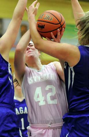 Siena's Meghan Donohue battles for a rebound during their basketball game against Niagara on Thursday, Feb. 12, 2015, at Siena College in Loudonville, N.Y. (Cindy Schultz / Times Union) Photo: Cindy Schultz / 00030600A