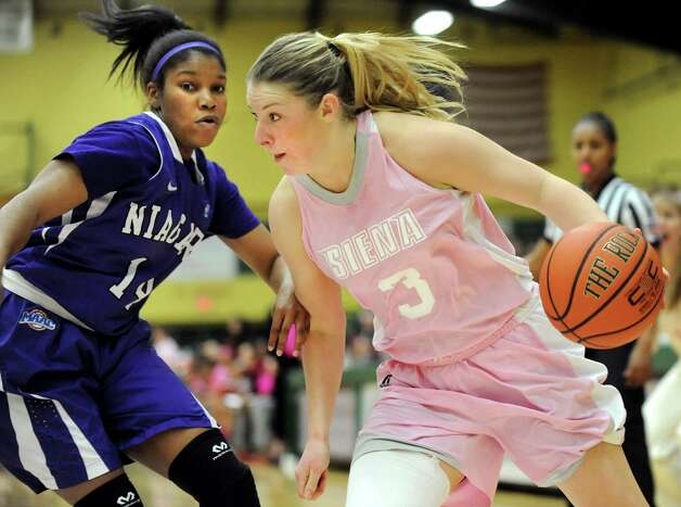 Siena's Brianna Logan, right, controls the ball as Niagara's Simone Hobdy defends during their basketball game on Thursday, Feb. 12, 2015, at Siena College in Loudonville, N.Y. (Cindy Schultz / Times Union) Photo: Cindy Schultz / 00030600A
