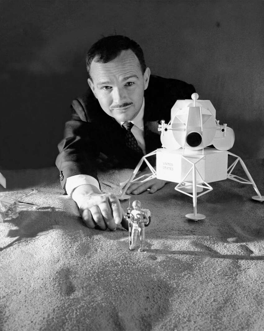 2/15/65: An astrogeologist shows a lunar surface model with a future lander and astronaut models. (This was more than four years before Apollo 11 landed the first manned mission on the moon.)