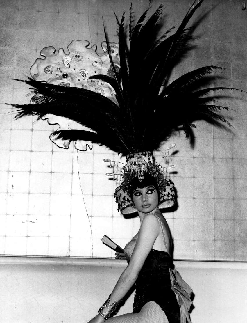2/15/65: Dancer Papou wears an elegant, feathered headdress for