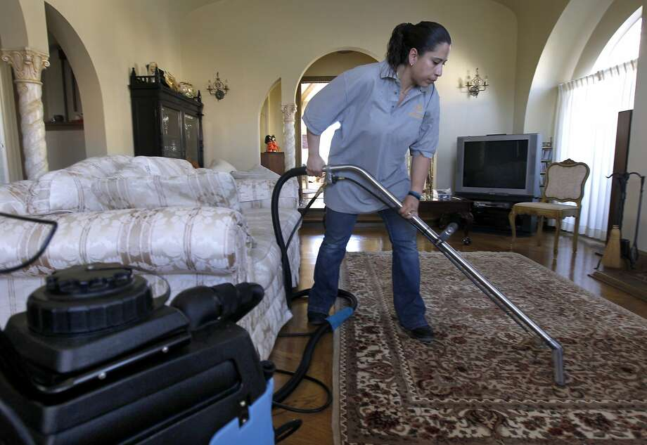 Rosa Sanchez cleans a San Francisco home last year for a Homejoy client. The on-demand tech startup has had a hard time keeping up with bigger competitors such as Handy. Photo: Paul Chinn, The Chronicle
