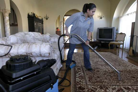 Rosa Sanchez, of Homejoy, steam cleans a rug for Rie Yamazaki-Bach in San Francisco, Calif. on Tuesday, Oct. 28, 2014. Many homeowners are turning to Homejoy to connect with maintenance services such as carpet cleaning, plumbing and painting.