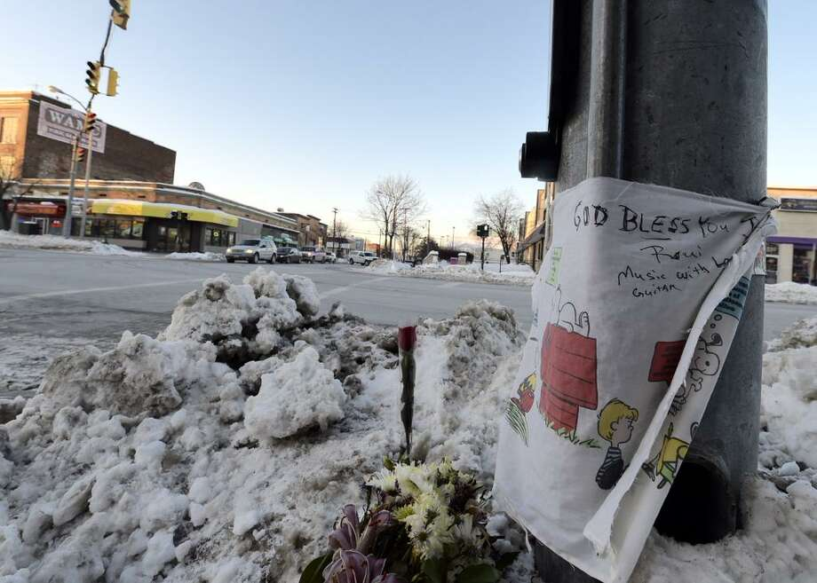 A memorial grows on Friday, Feb. 13, 2015, at Quail Street and Central Avenue in Albany where a 4-year-old child was killed Thursday. (Skip Dickstein/Times Union)