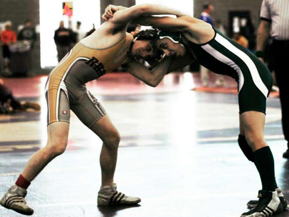 SPECTRUM/112-pounder Alex Thalassinos, right, of New Milford High School wrestling competes vs. Chris Catanzaro of RHAM in the Round of 16 at the state open tournament, Saturday, Feb. 27, 2010 at the New Haven Athletic Center. Photo: Norm Cummings / The News-Times