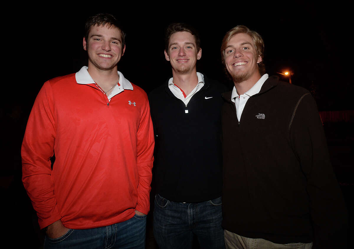From left, players Travis Moore, Jayson McKinley, and Ryan Erickson attended the pre-season party held for the Lamar University baseball team at the home of Sherrene Cook in Beaumont Thursday night. Photo taken Thursday, February 12, 2015 Kim Brent/The Enterprise