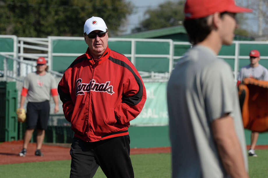 Jim Gilligan watches the Cardinals while walking around Vincent-Beck Stadium on Thursday. Gilligan could obtain his 1300th win this season. 