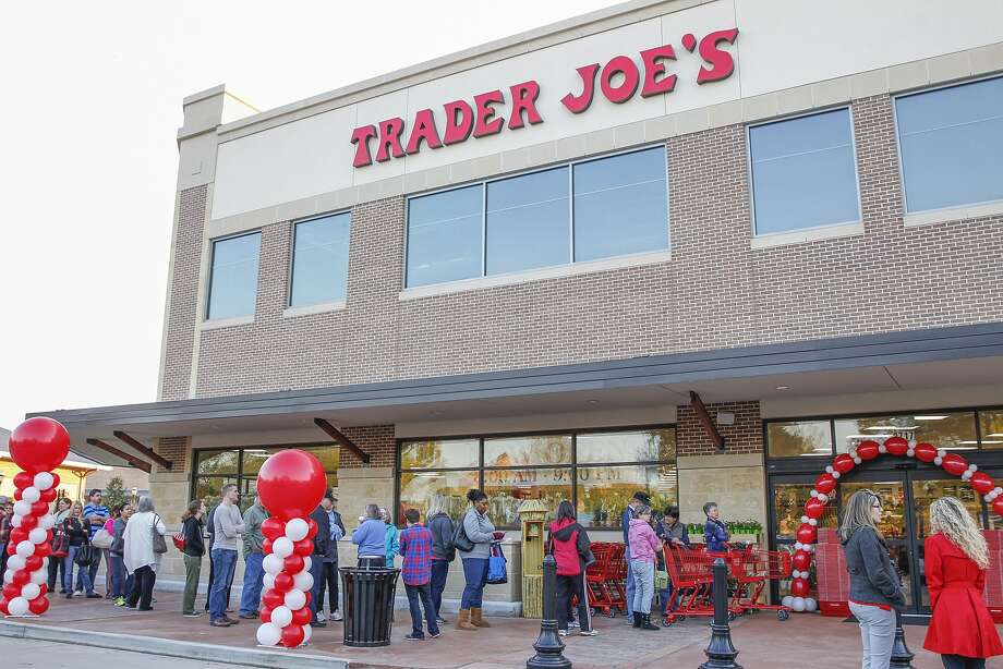 Shoppers lined up early Friday morning to be the first inside at the Grand Opening of Trader Joe's in La Centerra Shopping Center in Katy on February 13, 2015. Photo: Diana L. Porter, For The Chronicle / © Diana L. Porter