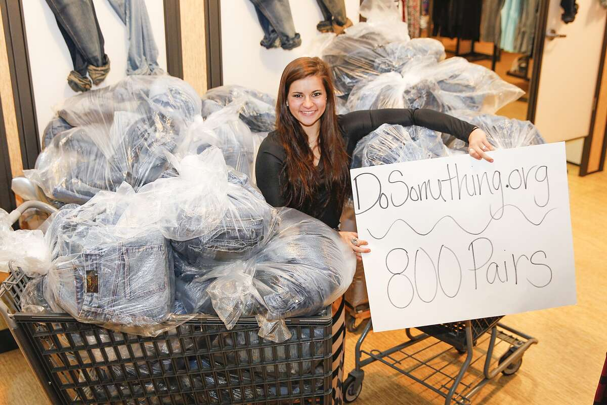 Peyton Green, a senior at Foster High School, is shown with the 800 pairs of jeans she is donating through DoSomething.org and Aeropostale located at Katy Mills Mall. Green will receive one entry for a $10,000 college scholarship for every two pairs of jeans she donates, resulting in 400 entries.