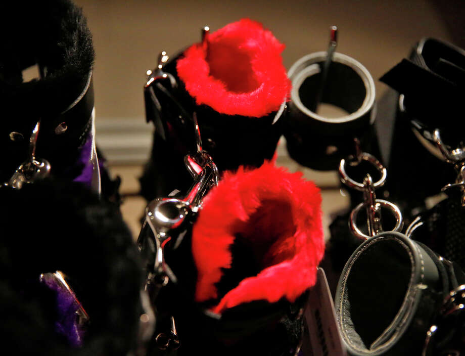 "A display in the Good Vibrations store on showcases a variety of handcuffs. The store features a display with a ""Fifty Shades of Grey"" theme to celebrate the movie's release on Valentine's Day. Photo: Leah Millis / The Chronicle / ONLINE_YES"