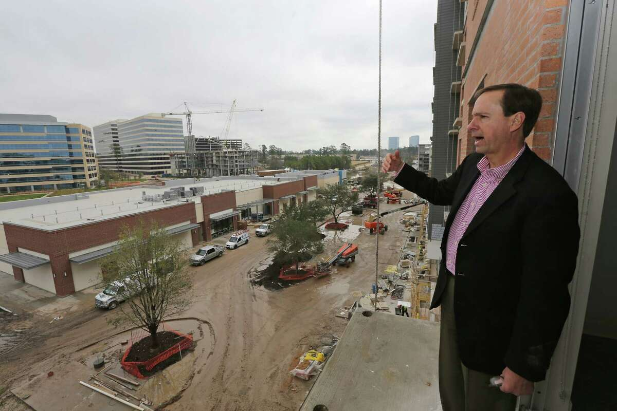 Paul Layne, Executive V.P. of Howard Hughes Corps. and executives tour The Woodlands of Hughes Landing mixed-use development and One Lakes Edge apartment project on Wednesday February 4, 2015 in The Woodlands, Texas. (For the Chronicle by Thomas B. Shea)