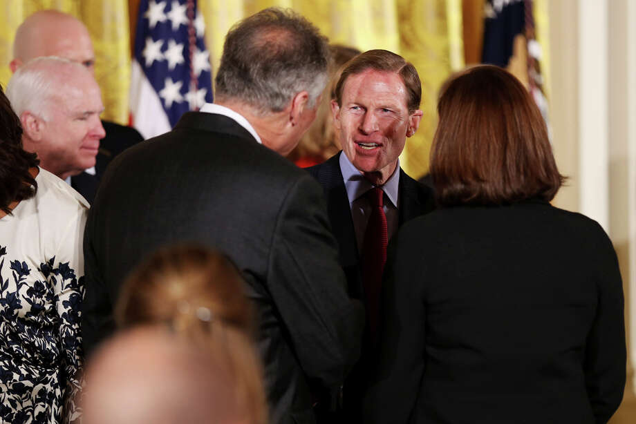Sen. Richard Blumenthal, D-Conn., speaks with Clay Hunt's parents after President Obama signed the Clay Hunt Suicide Prevention for American Veterans act Thursday, Feb. 12, 2015 in the White House. Photo: Connor Radnovich, Connor Radnovich/Hearst Media / Connecticut Post Contributed