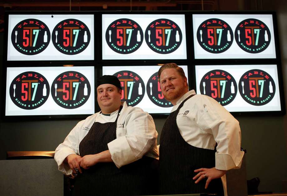 Chef Allen Duhon, left, with Chef Randy Evans, formerly of Haven, who is the consulting chef for this new venture at Table 57, opening in H-E-B's new store at 5895 San Felipe. Photo: Karen Warren, Staff / © 2015 Houston Chronicle