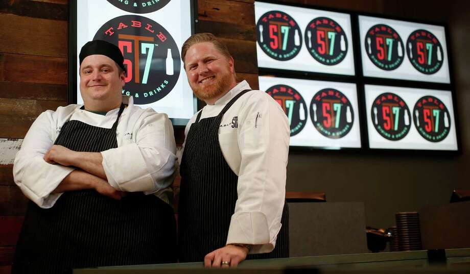 Chef Allen Duhon, left, with Chef Randy Evans, formerly of Haven, who is the consulting chef at Table 57, opening in H-E-B's new store at 5895 San Felipe. Photo: Karen Warren, Staff / © 2015 Houston Chronicle