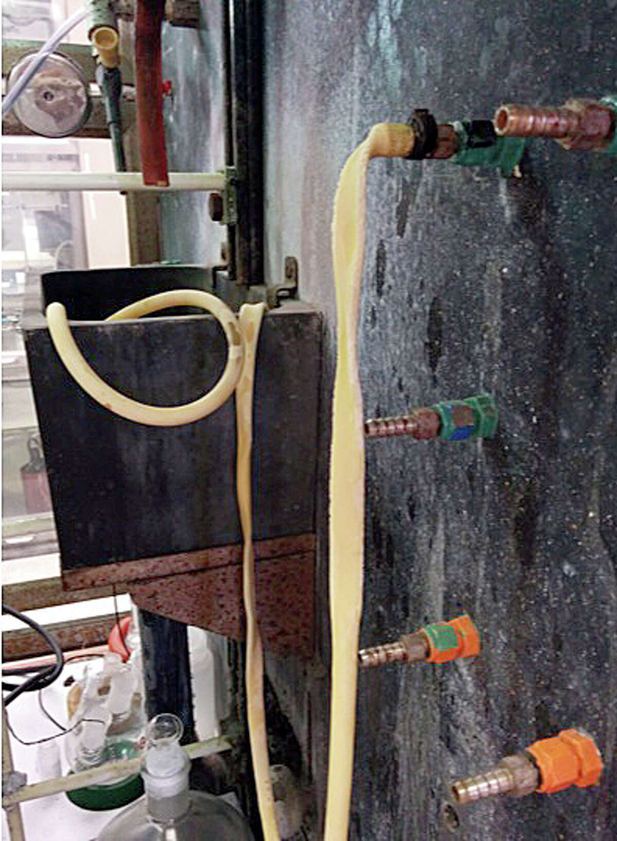 A look inside a DuPont LaPorte process lab in 2014. This old and apparently useless tubing had been left in place for years. None of the labs' monthly safety inspections seemed to affect multiple housekeeping and safety issues, said former DuPont lab technician Barbara Acker.