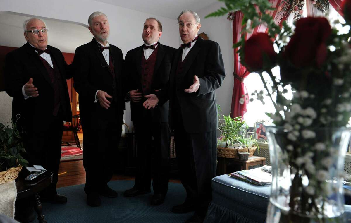 A quartet from the Coastal Chordsmen serenade Dee Lesak at her Stratford home Friday, Feb. 13, 2015 in honor of Valentine's Day. From left, Ron Rubano, of Trumbull, Phil Kraft, of Darien, Stephen Fians, of Trumbull, and Jim Farrell, of Bridgeport, sing the Cole Porter song