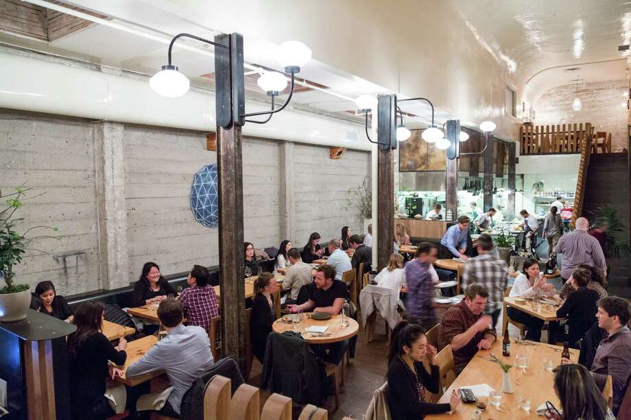 Diners eat in the main space at The Progress restaurant in San Francisco. Photo: Jason Henry / Special To The Chronicle / ONLINE_YES
