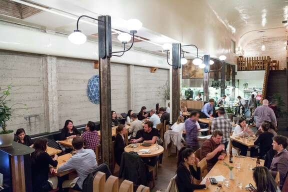 Diners eat in the main space at The Progress restaurant in San Francisco.
