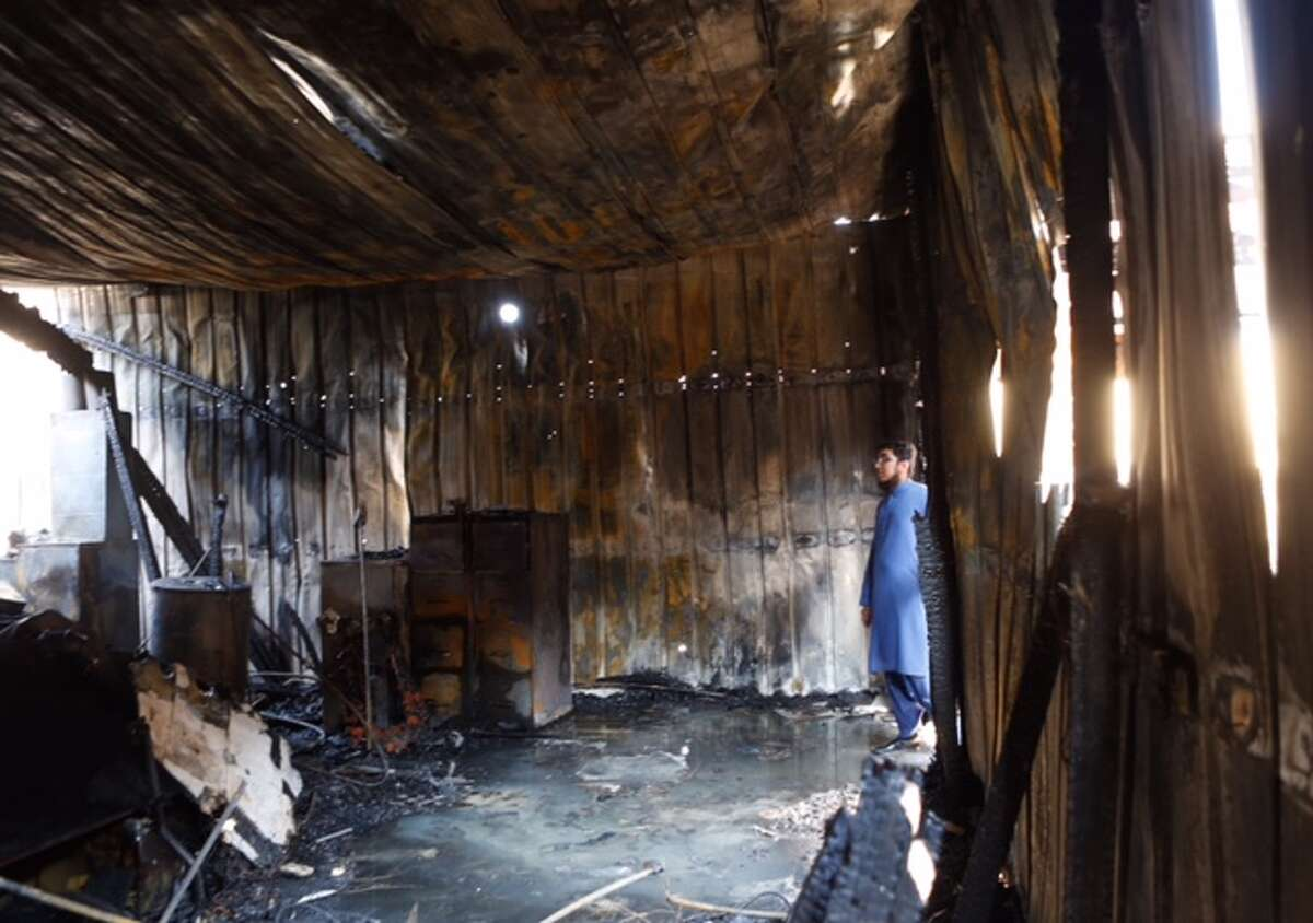 Ahsan Zahid, assistant imam, walks through the charred Quba Islam Institute after it burned Feb. 13.