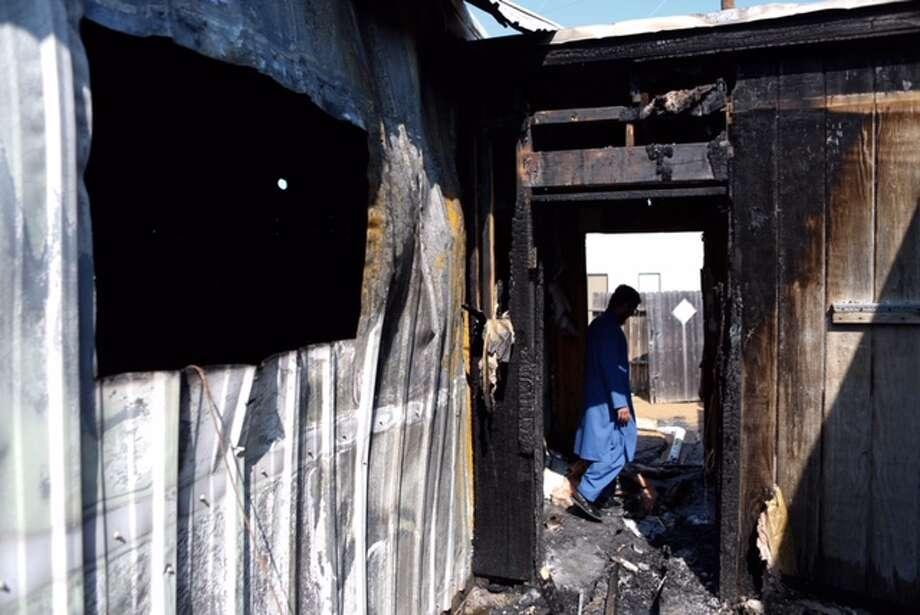 Ahsan Zahid, assistant Imam, walks through the charred Quba Islam Institute after it burned Friday morning, Feb. 13, 2015. Photo: Cody Duty / Houston Chronicle