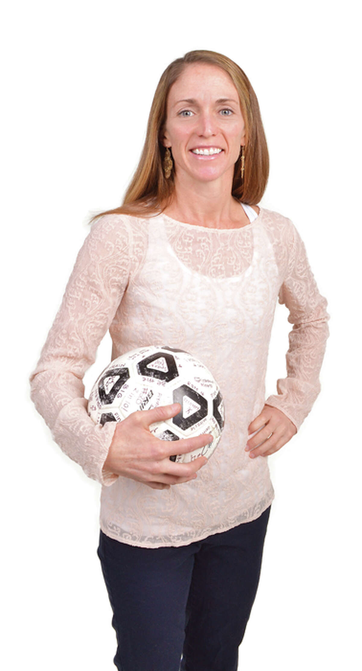 Holli L. Nirsberger, Physical Education Teacher, Varsity Girls Soccer Coach at Shenendehowa Central Schools. She holds the game ball that has each point scored by the team written on it.