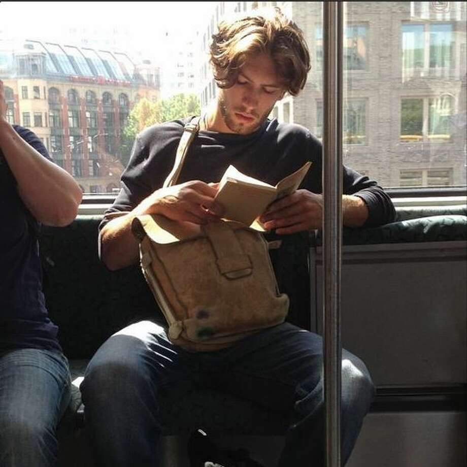 """Spotted this scruffy prince on his morning commute. Probably to sculpture class. I'm sure he's reading a collection of post-war Russian short stories, but really thinking of how he made love to his French girlfriend this morning and the gluten free toast they shared after. #marryme #hotdudesreading""-Via Instagram Photo: Molina,  Maribel, Hotdudesreading/Instagram"