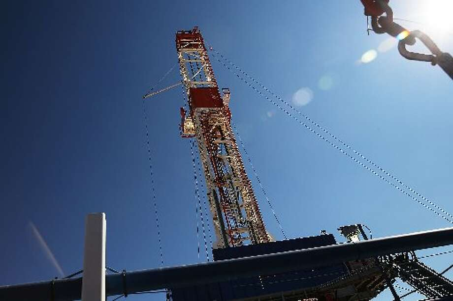 The Patterson 298 natural gas fueled drilling rig on land in the Permian Basin that is owned by Apache Corp. on February 5, 2015 in Mentone, Texas. The rig, which is only 21 days old, is the first drilling rig in Texas that is 100-percent fueled by natural gas. Apache is among the oil and gas companies slashing its drilling budget in the wake of low crude oil prices. (Photo by Spencer Platt/Getty Images)