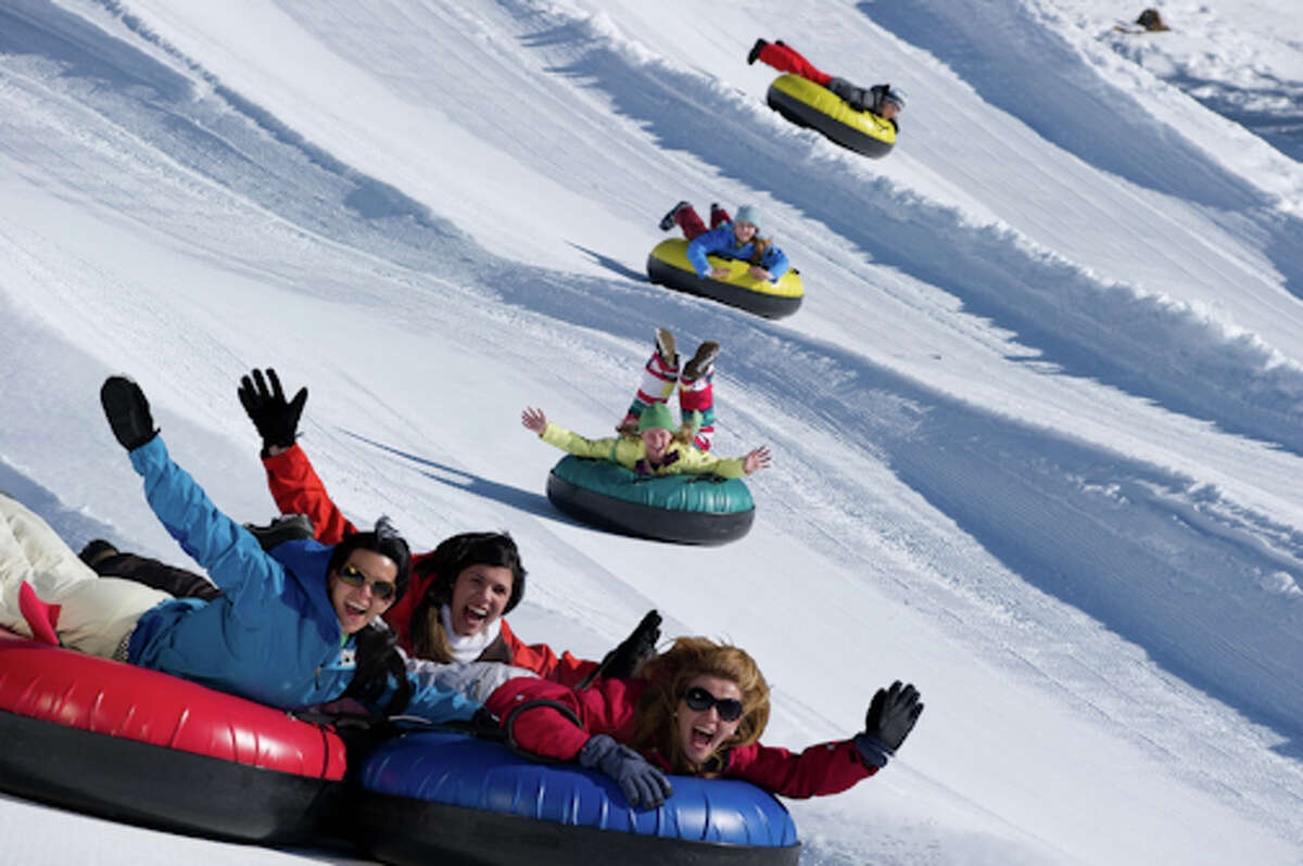 Tubers enjoy a slide down Heavenly Mountain Resort at Lake Tahoe.