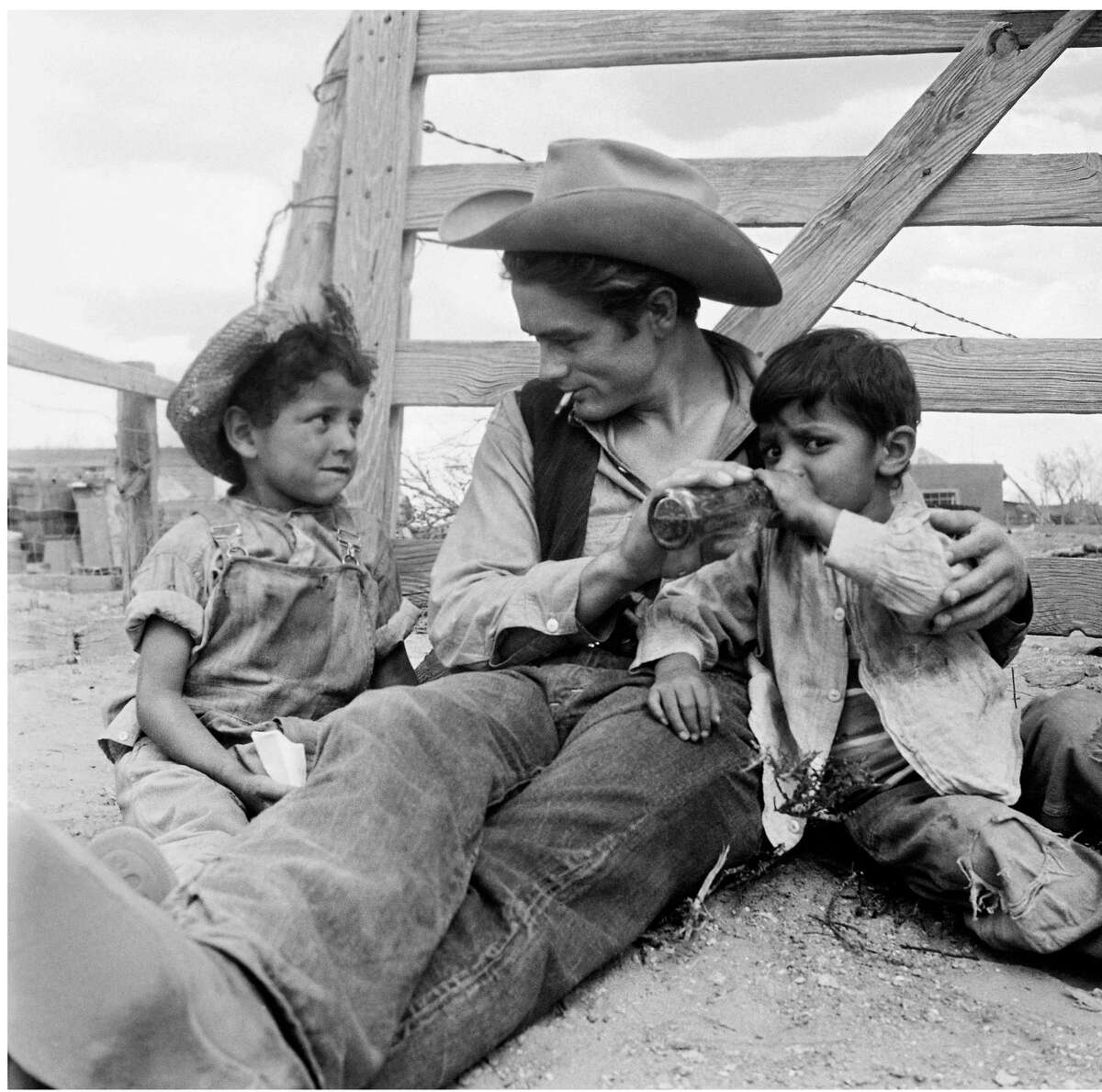 Actor James Dean interacts with two Latino children on the set of the film